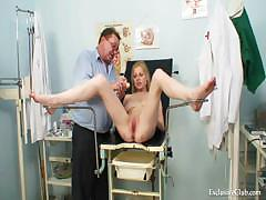 Gynecological pussy exam of naturaly big titted blondie