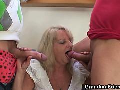 blonde-grandma-swallows-two-big-dicks