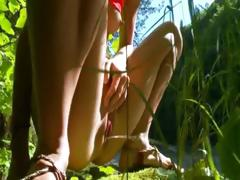 petite-french-chick-peeing-in-a-forest