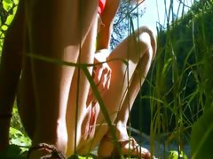 petite-spanish-chick-peeing-in-a-forest